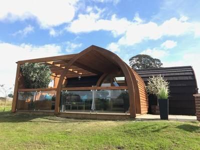 Daisy Luxury Glamping Pod with outdoor lounge area